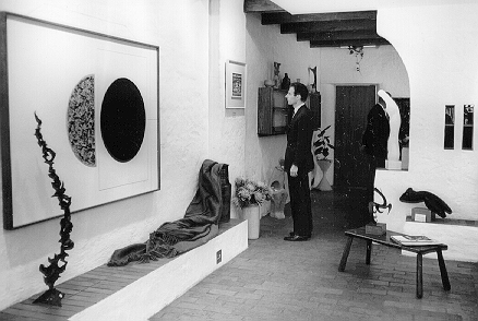 Fernand F. Haenggi at Gallery 101, Rand Central, Johannesburg, in 1966, viewing works by Johan van Heerden, Ernst de Jong, Walter Battiss and others