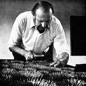 Eduard LADAN working on one of his nail assemblages in 1970 (photo by David Baker, Cape Town)