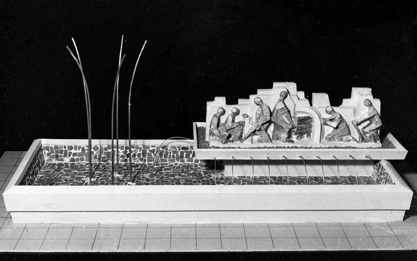 "Lily SACHS - Model for fountain outside ""Edura"" - panel of bronze figures depicting a mining scene against concrete background, jets of water at left"
