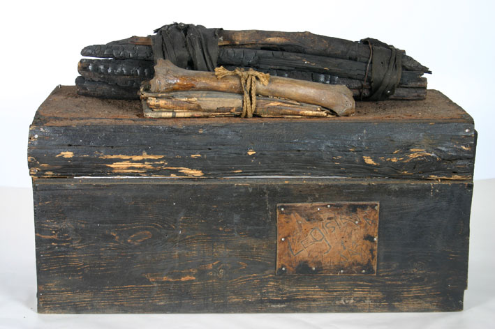 "Lucas SEAGE ""Coffin of the migrant worker"" - Wood, nails, bones, found materials - 46.0x70.3x27.6 cm (Donated to WAM by Lionel Murcott in 1995)"